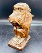 An Antique carved nut cracker in the style of a Monkey.