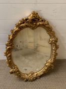A Rocco style mirror with gilt plaster frame (43cm x 60cm)