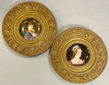 Two metal charges with painted portraits plates centre