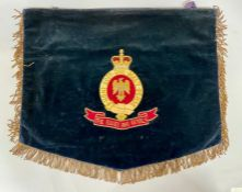 An Antique Blues and Royals embroidered trumpet banner