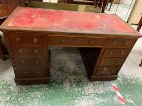 A kneehole desk with red leather top (H75cm W130cm D59cm)