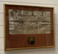 A King Charles I charter with part of a seal.