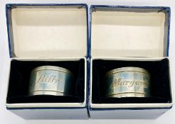 A pair of boxed hallmarked silver napkin rings engraved Billy and Margaret
