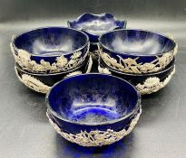 A Set of six silver Chinese bowls with blue glass liners, various patterns.