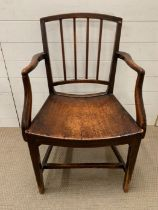 A Sheraton mahogany dining armchair with square back, four reeded vertical splats and solid seat