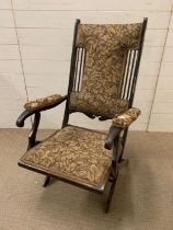 An Edwardian mahogany steamer chair