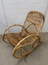 A Mid Century bamboo rocking chair