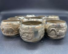 A Selection of twelve Ceylon silver napkin rings (Approx weight 320g)