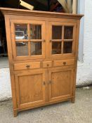 A glazed cabinet with doors opening to reveal shelves, three drawers and cupboard below (H171cm