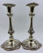 A pair of silver plated, weighted single candlesticks