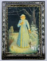 A Russian Lacquered box (9.5cm x 7cm x 3.5cm) picture of a woman in blue coat and hat, signed.