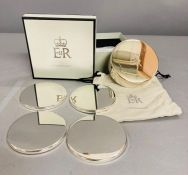 A boxed set of coasters Christmas 2008 Queen Elizabeth II given as a gift to a member of the Royal