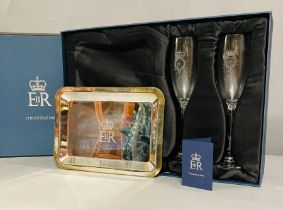 A pair of Champagne flutes and a silver plated tray given as a gift to a member of the Royal