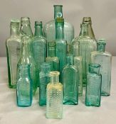 A large collection of turquoise glass bottles