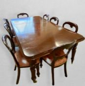 A Victorian style mahogany extending dining table, the top with double moulded edge above a