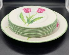 A selection of floral plates, eight plates and one larger one by Sally Crosthwaite for Carolyn