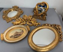 A selection of gilt frame mirrors and small tray.