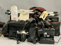 A large volume of photography equipment, cameras etc.