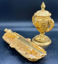 A selection of gilt tableware, knifes and knife rest, caviar holder etc