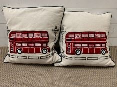 Two London bus throw cushions