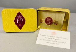 A wrapped piece of cake in a tin to celebrate the Diamond Wedding anniversary of Her Majesty the