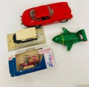 Four various toy vehicles