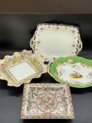 Four china decorative handed plates and side dishes