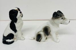 Two china dog figures
