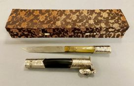 A boxed paper knife