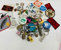 A selection of various badges and keyrings