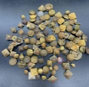A large selection of Military insignia, buttons etc, various regiments and ages.
