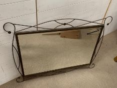 A modern mirror with metal work to frame (110cm x 84cm)