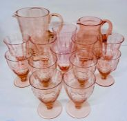 A selection of pink glass consisting of goblets and jugs