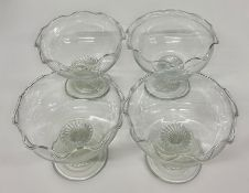 Four glass dishes with twisted stem