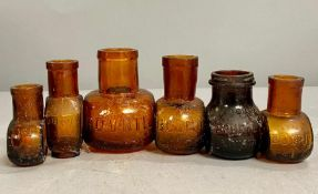 A collection of glass Bovril jars