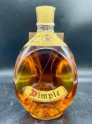 A bottle of Dimple old blended scotch whisky