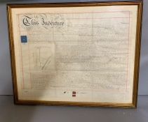 A 19th century indenture, framed and glazed (82cm x 68cm).