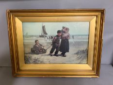 A print with Children playing on beach, framed and glazed (62cm x 45cm)