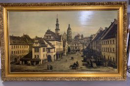 A print on canvas of a town square in a gilded frame (59cm x 104cm).