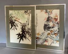A pair of oriental prints, framed and glazed. (32cm x 47cm)