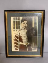 A coloured print of a young solider, framed and glazed (24cm x 33cm).