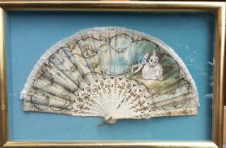 A Victorian hand painted and mother of pearl fan with a scene galante and floral gilt decorated