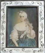 A 19th century French miniature depicting a 18th century french lady taken off a veil, gouache on