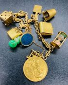 A 9ct gold charm bracelet with a variety of charms and a 1907 sovereign.