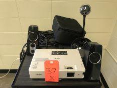 Lot - (1) Epson 3LCD Projector (1) Logitech Speaker System (1) Camera (Room 301)