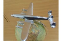 BEAUTIFUL MODEL OF POLISHED ALUMINIUM 4 ENGINE AIRCRAFT MOUNTED ON TOP OF HIGH QUALITY GLOBE