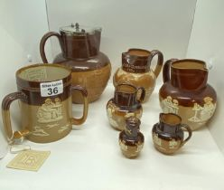 A quantity of antique Doulton Lambeth ware jugs/pitchers/vessels in various sizes including ; a