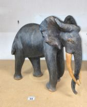 Hand carved hardwood African Elephant in standing stance, approx. H46cm, A/F to ear