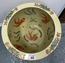 A large glazed oriental vase/planter with fish scenes to interior, on hardwood stands, with