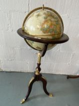 Royal Geographical Society World Globe, raised on tripod stand with gilt detailing , approx. H100cm